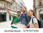 young happy tourists holding... | Shutterstock . vector #579707290