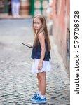 adorable happy little girl... | Shutterstock . vector #579708928