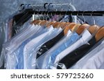 rack of clean clothes hanging...   Shutterstock . vector #579725260