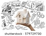 hand holding small house with... | Shutterstock . vector #579729730