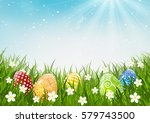 color easter eggs on green grass | Shutterstock .eps vector #579743500