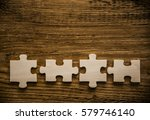 four brown pieces of puzzle lie ... | Shutterstock . vector #579746140