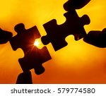 two hands trying to connect... | Shutterstock . vector #579774580