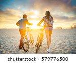 couple walking bikes together... | Shutterstock . vector #579776500