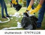 male hands in yellow rubber... | Shutterstock . vector #579791128