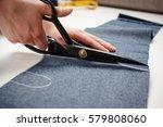 hands of seamstress cutting a ... | Shutterstock . vector #579808060