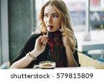 a girl talks by phone  has... | Shutterstock . vector #579815809