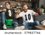 excited young men with beer... | Shutterstock . vector #579837766