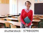 portrait of happy teacher in... | Shutterstock . vector #579843094