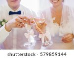 bride and groom clang chmapagne ... | Shutterstock . vector #579859144