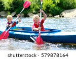 two boys kayaking on the river. ...   Shutterstock . vector #579878164