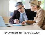 woman meeting notary for advice   Shutterstock . vector #579886204