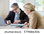 woman meeting notary for advice | Shutterstock . vector #579886306