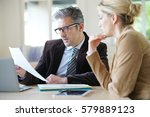 Stock photo woman meeting notary for advice 579889123