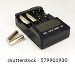 Small photo of Intelligent accumulator battery charger on the white background