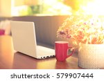 red cup of coffee on the desk... | Shutterstock . vector #579907444