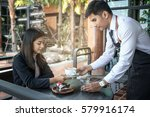close up of man serving coffee... | Shutterstock . vector #579916174