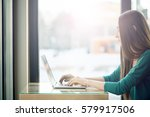young woman typing on computer... | Shutterstock . vector #579917506
