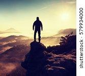 man silhouette climbing high on ... | Shutterstock . vector #579934000