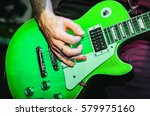 Musician Blurred Hands On Gree...