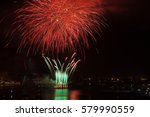 red firework over the water in... | Shutterstock . vector #579990559