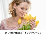 young beautiful woman holding... | Shutterstock . vector #579997438
