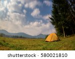 tent at night on a background... | Shutterstock . vector #580021810
