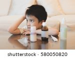 Small photo of A kid feel unhappy to eat the medicine, his face feeling bored