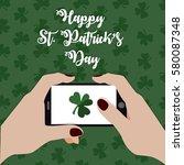 happy st. patrick's day. hands... | Shutterstock .eps vector #580087348