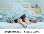 feet of lovers couple lying on... | Shutterstock . vector #580112398