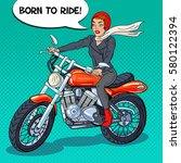 pop art biker woman in helmet... | Shutterstock .eps vector #580122394