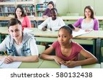 young happy students studying... | Shutterstock . vector #580132438
