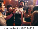 group of friends having drinks... | Shutterstock . vector #580144114