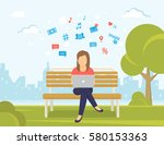 young woman sitting in the park ... | Shutterstock .eps vector #580153363