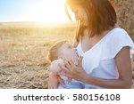 beautiful happy mother... | Shutterstock . vector #580156108