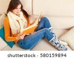 girl reads a book lying at... | Shutterstock . vector #580159894