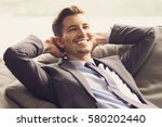 smiling businessman with hands... | Shutterstock . vector #580202440