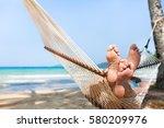 happy couple family in hammock...   Shutterstock . vector #580209976