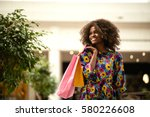 beautiful curly haired afro... | Shutterstock . vector #580226608