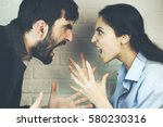 young couple yelling at each... | Shutterstock . vector #580230316