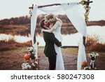 bride and groom on wedding... | Shutterstock . vector #580247308