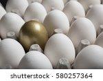 golden egg standing out from a... | Shutterstock . vector #580257364