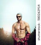 handsome fit man posing... | Shutterstock . vector #580262914