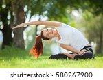 yoga outdoor. happy woman doing ...   Shutterstock . vector #580267900