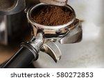 ground coffee in a portafilter... | Shutterstock . vector #580272853