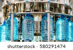 filling bottles with water | Shutterstock . vector #580291474