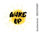 wake up. message on yellow ink... | Shutterstock .eps vector #580295089