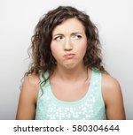 depressed  sad woman over white ... | Shutterstock . vector #580304644