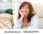 attractive middle aged woman... | Shutterstock . vector #580305994