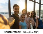young people group in airport... | Shutterstock . vector #580312504